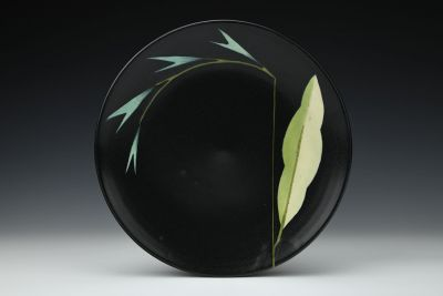 Black Plate with Blue Pointy Flowers
