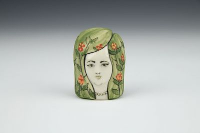 Little Lady Head with Green Hair and Red Flowers