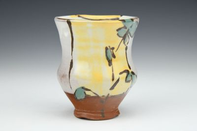 Teal Floral Cup with Yellow Background